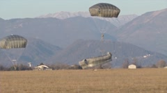 U.S. Army paratroopers jump from a C-130 Hercules Stock Footage