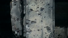 Bullet holes in the wall of the house.  Military ruins. - stock footage