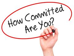 Man Hand writing How Committed Are You? with black marker on visual screen - stock photo