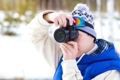 Winter sports Photographer - stock photo