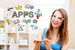 Apps concept with young woman using her smartphone Stock Photos