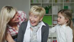 Grandmother receives present from her family - stock footage