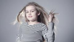 Portrait of beautiful child girl model with long hair. Stock Footage