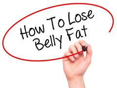 Man Hand writing How To Lose Belly Fat with black marker on visual screen - stock photo