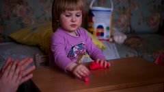 Girl Sculpts Plasticine on Table, Watch With Interest - stock footage