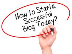 Man Hand writing How to Start a Successful Blog Today? with black marker on v - stock photo