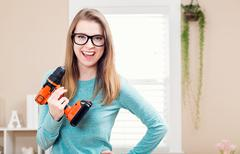 Young woman with cordless drill - stock photo