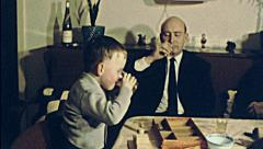Austria 1960s: father and son drinking a toast at home Stock Footage