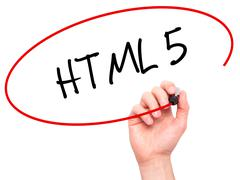Man Hand writing HTML 5 with black marker on visual screen - stock photo