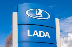 Official dealership sign of Lada. Lada is a Russian automobile manufacturer - stock photo
