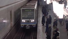 Train arrives and departs from Moscow metro station Kurskaya, zoomed. 16-02-2016 Stock Footage