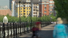 River Ishim, people walk on the waterfront timelapse, buildings, premises Stock Footage