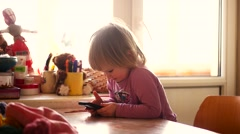 Caucasian Blonde Child Watching Cartoon on Device, Little Girl Playing, Surfing - stock footage