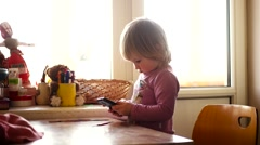 Caucasian Blonde Child Watching Cartoon on Device, Little Girl Playing, Surfing Stock Footage