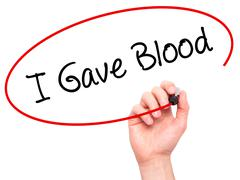 Man Hand writing I Gave Blood with black marker on visual screen - stock photo