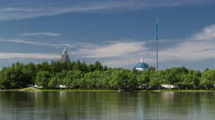 River Ishim timelapse, buildings, premises, tratuar and trees in park. Sunny day Stock Footage