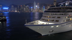 Large luxury cruise ship, Hong Kong skyline, night, travel, holiday, vacation Stock Footage