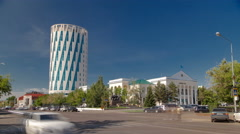 Exterior of the square next to the council of Astana city building with traffic Stock Footage