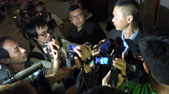 Hong Kong journalists, police officer, interview, television crew, broadcast Stock Footage