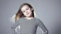 Portrait of beautiful child girl model with long hair posing in studio. - stock footage