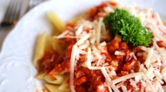 Penne pasta with vegetable bolognese and parmesan. - stock footage