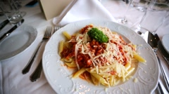 Penne pasta with vegetable bolognese and parmesan. Stock Footage