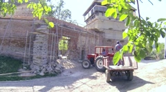 Tractor with trailer entering the precincts of a medieval fortress Stock Footage