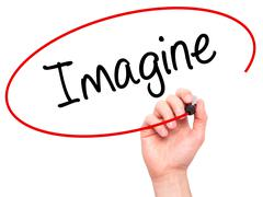 Man Hand writing Imagine  with black marker on visual screen - stock photo