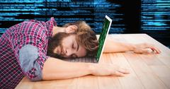 Composite image of hipster napping with head on laptop Kuvituskuvat