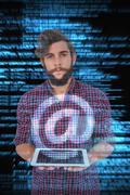 Composite image of portrait of hipster holding digital tablet Kuvituskuvat