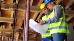 Stock Video Footage of engineer or architect discussing construction issues with colleague
