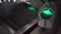 Green arrow traffic signal near escalator Stock Footage