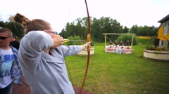 Girl shoot a bow. - stock footage