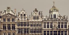 Vintage Brown Filter on Historical Buildings of Brussels in Grand Place - stock photo