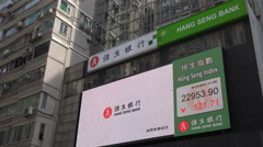Advertising board displays commercials and stock exchange details Hong Kong Stock Footage