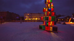 The lighted Christmas tree in the park with snow Stock Footage