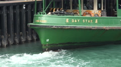 Bow of a departing Star Ferry in the Victoria Harbor in Hong Kong Stock Footage