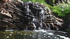 Artificial waterfall in park Stock Footage