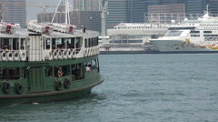 Hong Kong Star Ferry sails through Victoria Harbor Stock Footage