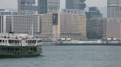 Hong Kong travel, classic Star Ferry sails through Victoria Harbor, Kowloon - stock footage