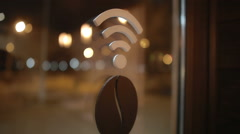 Wi fi sign on evening window - stock footage