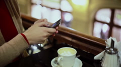 Woman hands texting, using smartphone in cafe Stock Footage