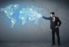 Business person showing digital map with planes around the world - stock photo
