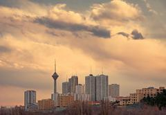Skyline of Tehran at Sunset with Warm Orange Tone - stock photo
