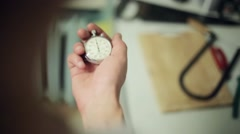 Man hands hold and push button of old round stopwatch Stock Footage