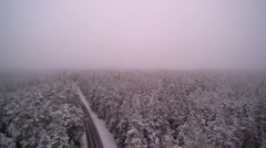 Aerial look of the snowy and foggy air Stock Footage