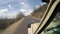 Landcruiser driving up a mountain road Stock Footage