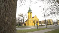 Yellow church between the gray block of flats - stock footage