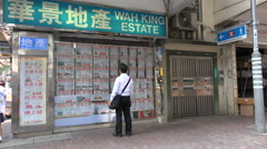 Customer looks at advertisements of real estate broker in Hong Kong Stock Footage