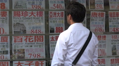 Soaring property prices, social problem, realtor, advertising, homes, Hong Kong - stock footage